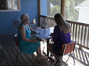 Enjoy on our screened in, covered patio - rain or shine!
