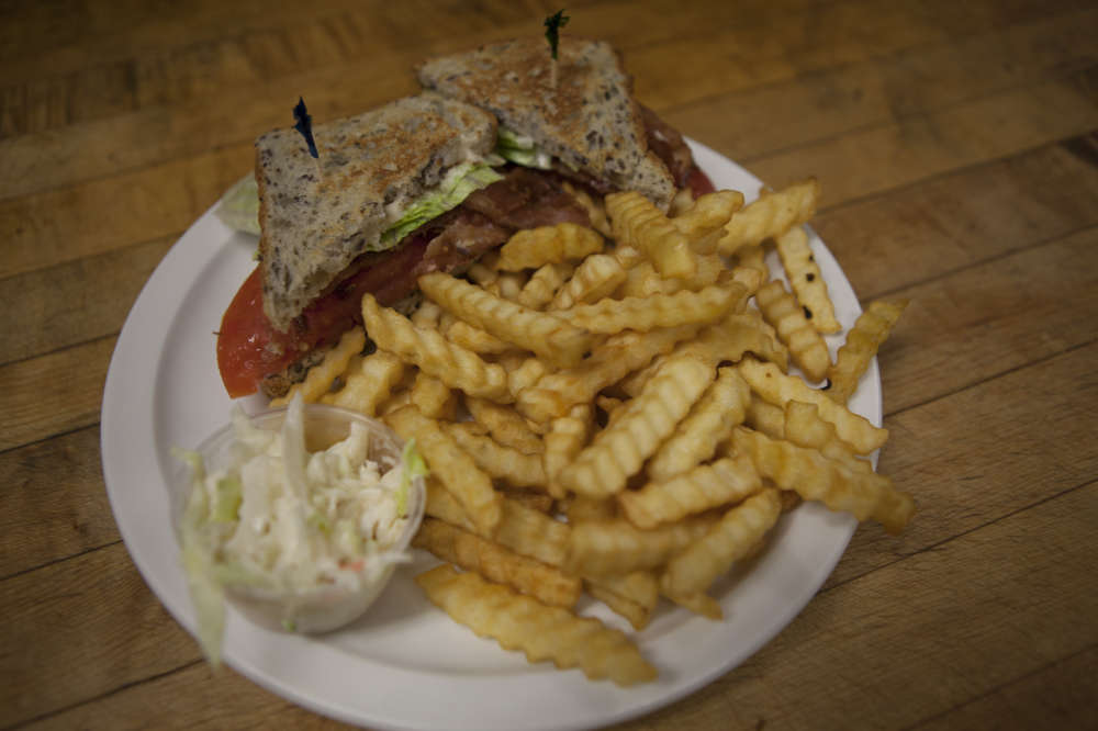 A BLT with classic fries.